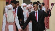 Braving the rain, 200 Palestinian couples hold mass wedding