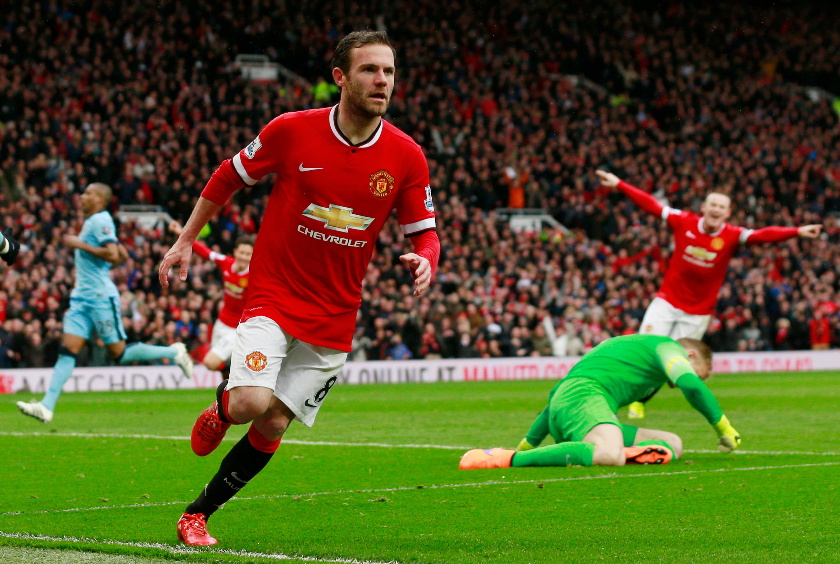 Juan Mata celebrates scoring the third goal for Manchester United Action Images via Reuters / Jason Cairnduff Livepic