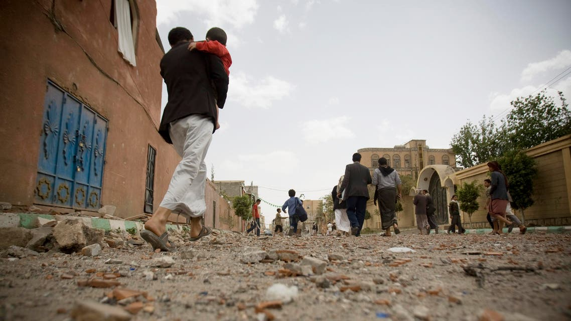 In this Wednesday, April 8, 2015 file photo, people flee after a Saudi-led airstrike in Sanaa, Yemen. A state-run broadcaster in Iran is reporting that the Islamic Republic has sent a navy destroyer and another vessel to waters near Yemen amid a Saudi-led airstrike campaign. (AP Photo/Hani Mohammed, File)