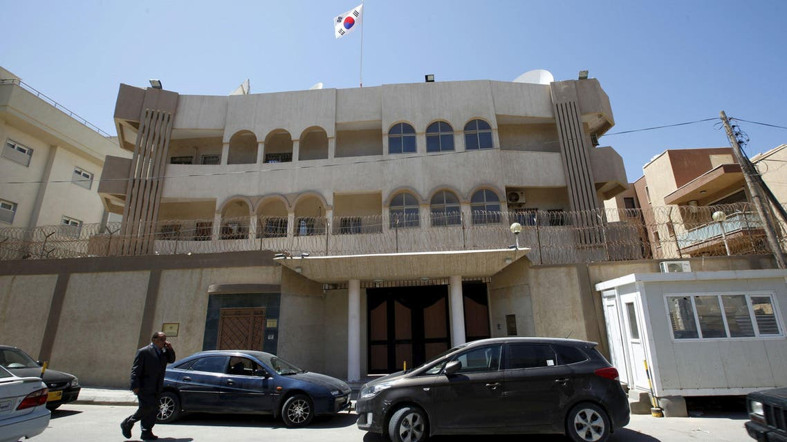 A man walks past the South Korean embassy after it was attacked by gunmen in Tripoli April 12, 2015. (Reuters)