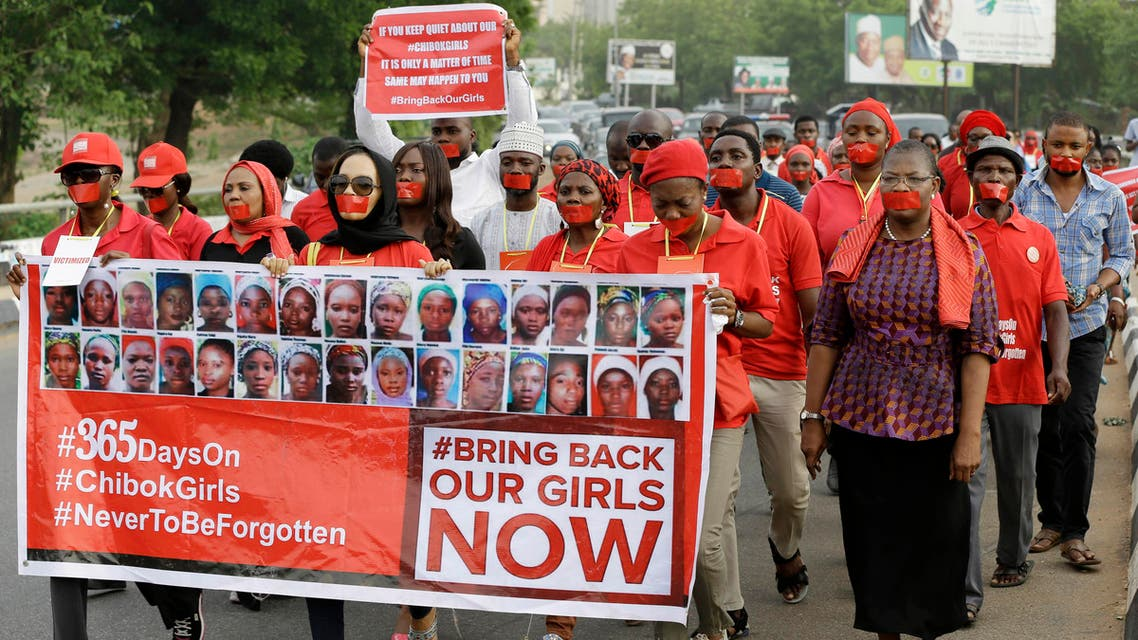 People march during a silent protest calling on the government to rescue the kidnapped girls of the government secondary school in Chibok, who were abducted a year ago, in Abuja, Nigeria, April 13, 2015. (AP)