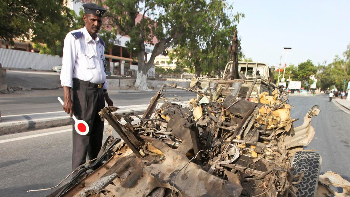 A Somali traffic policeman stands near the wreckage of a suicide car bomb in Mogadishu, Somalia Thursday, Jan. 22, 2015. (File Photo: AP)
