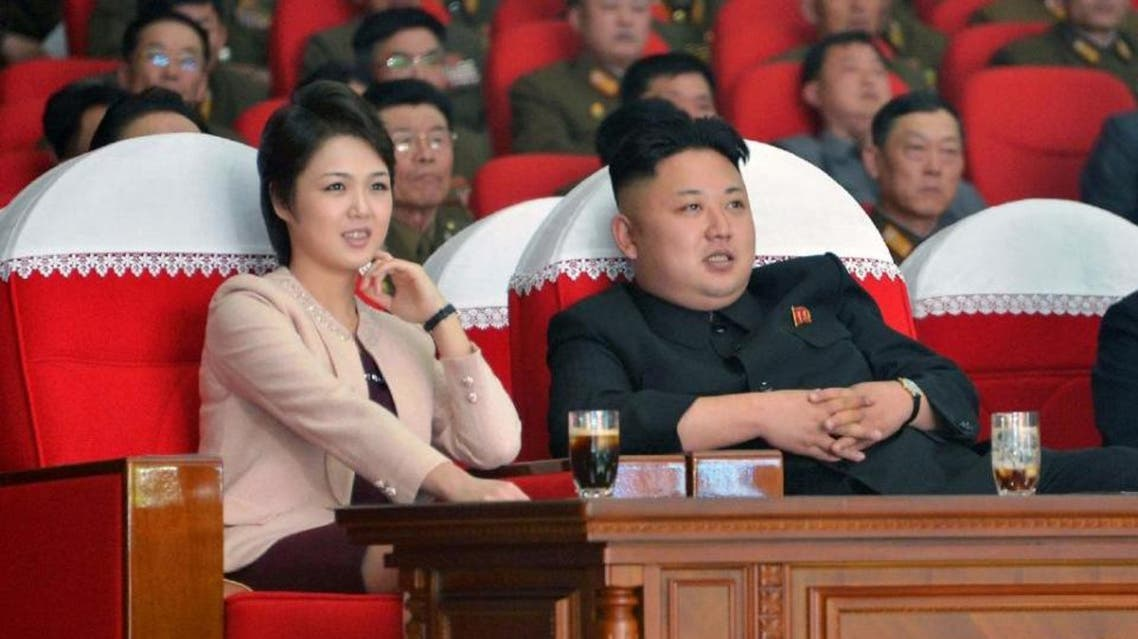 North Korean leader Kim Jong-Un and his wife Ri Sol-Ju watches a performance by the Moranbong Band at the April 25 House of Culture on March 22, 2014. (File Photo: AFP)