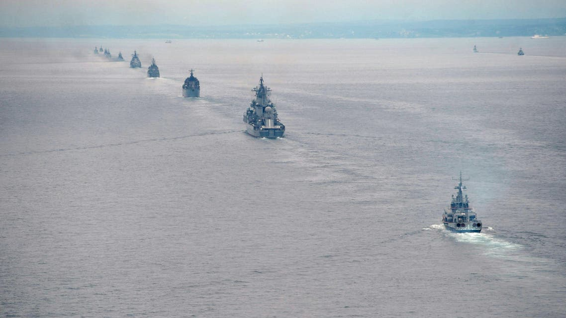 In this Tuesday, July 16, 2013 file photo Russian Pacific Navy ships sail near the Sakhalin Island during military exercises. With hundreds of new aircraft, tanks and missiles rolling off assembly lines and Russian jets buzzing European skies under NATO's wary eye, it doesn't look like Russia's economic woes have had any impact on the Kremlin's ambitious military modernization program. (AP Photo/RIA Novosti, Alexei Nikolsky, Presidential Press Service, File)