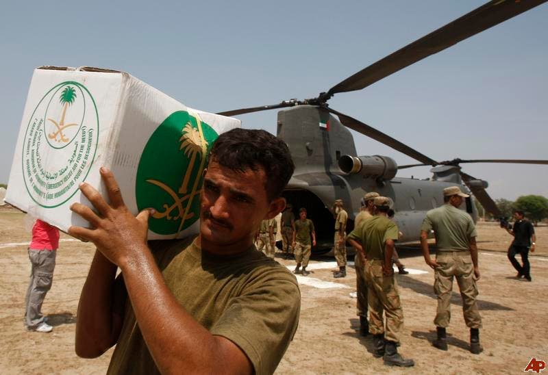 A Pakistani soldier carries aid supplies from Saudi Arabia, in Retra town about 55 kms north west of Multan, Pakistan, Wednesday, Aug. 18, 2010. (AP Photo/Kamran Jebreili)