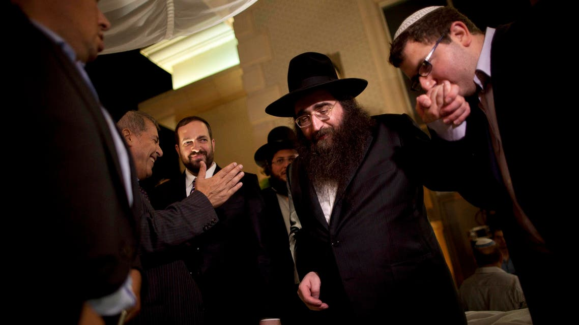 In this July 11, 2011 file photo, a man kisses the hand of Rabbi Yoshiyahu Pinto at a wedding in Lod, central Israel. (File Photo: AP)