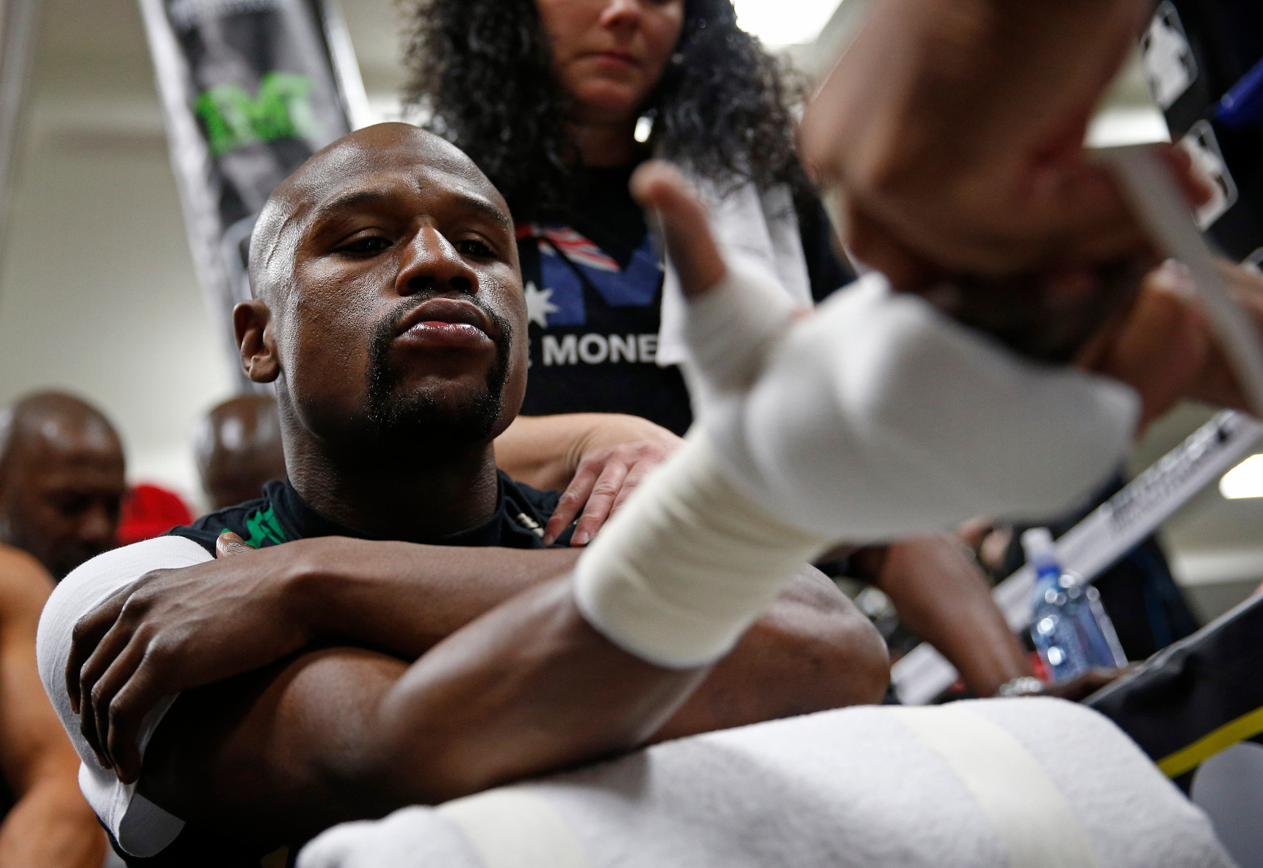 Boxer Floyd Mayweather Jr., left, works out with his uncle Roger Mayweather Tuesday, April 14, 2015, in Las Vegas. Mayweather will face Manny Pacquiao in a welterweight boxing match in Las Vegas on May 2. (AP Photo/John Locher)