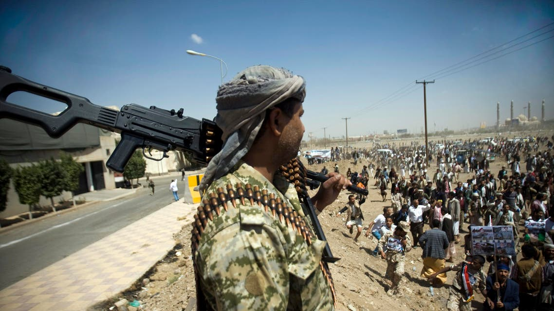 A Yemeni soldier stands guard as supporters of Ahmed Ali Abdullah Saleh, the son of Yemeni former President Ali Abdullah Saleh, gather during a demonstration. (AP)