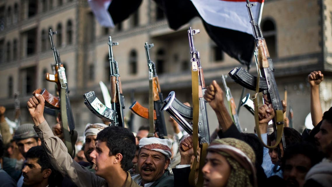 Shiite rebels, known as Houthis, hold up their weapons as they attend a protest against Saudi-led airstrikes in Sanaa, Yemen, Friday, April 10, 2015.  (AP)