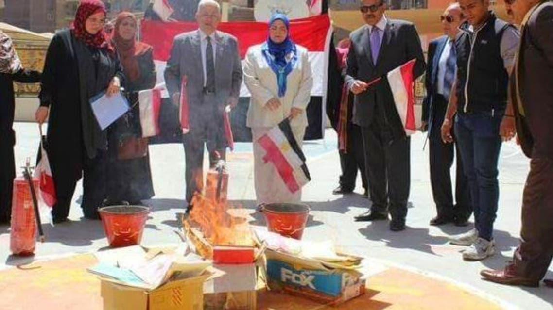 Egypt book burning woman (Photo courtesy: Twitter)