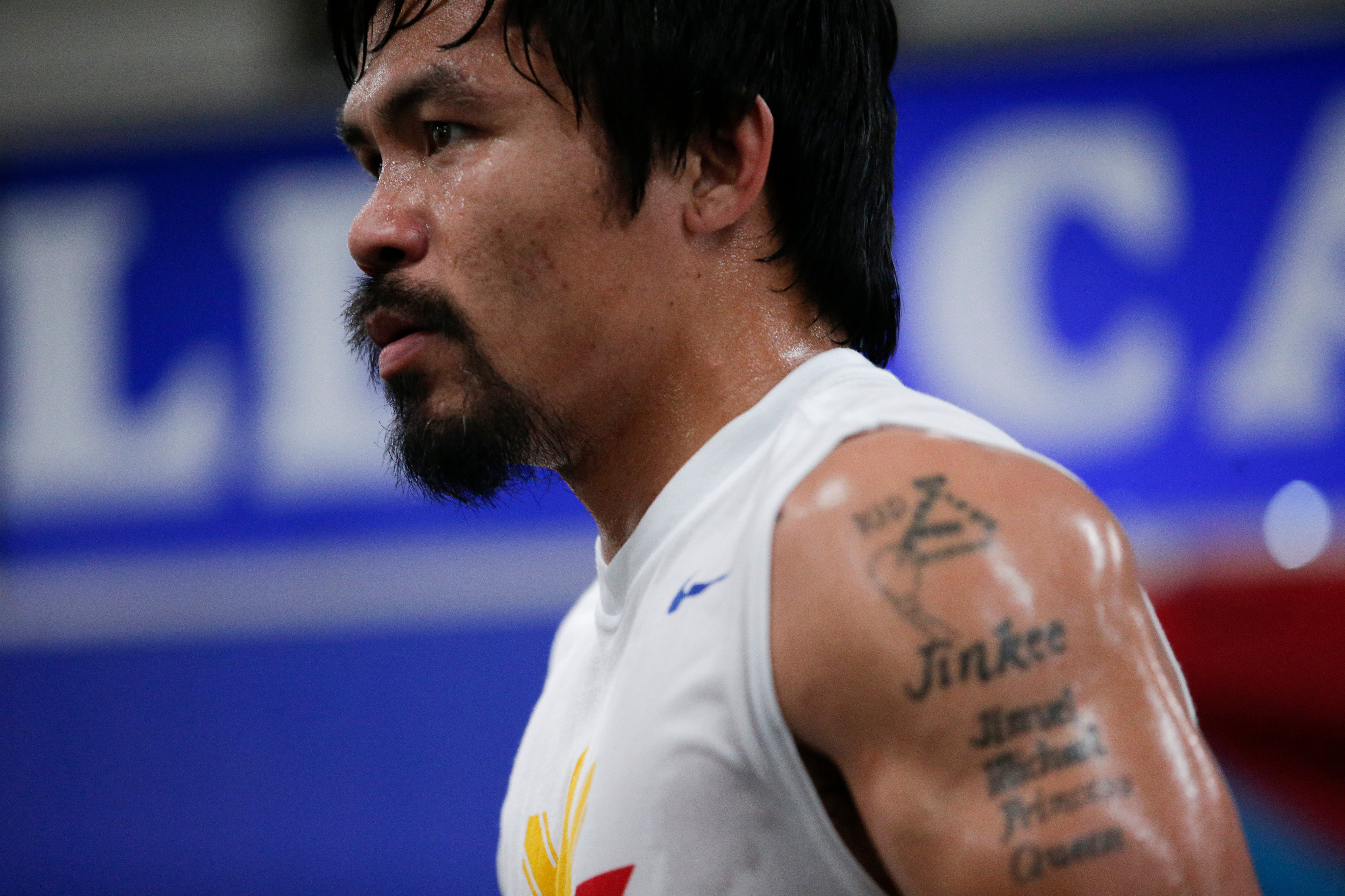 Boxer Manny Pacquiao, of the Philippines, is covered in sweat during his workout, Monday, April 13, 2015, in Los Angeles. Pacquiao will face Floyd Mayweather Jr. in a welterweight boxing match in Las Vegas on May 2. (AP Photo/Jae C. Hong)