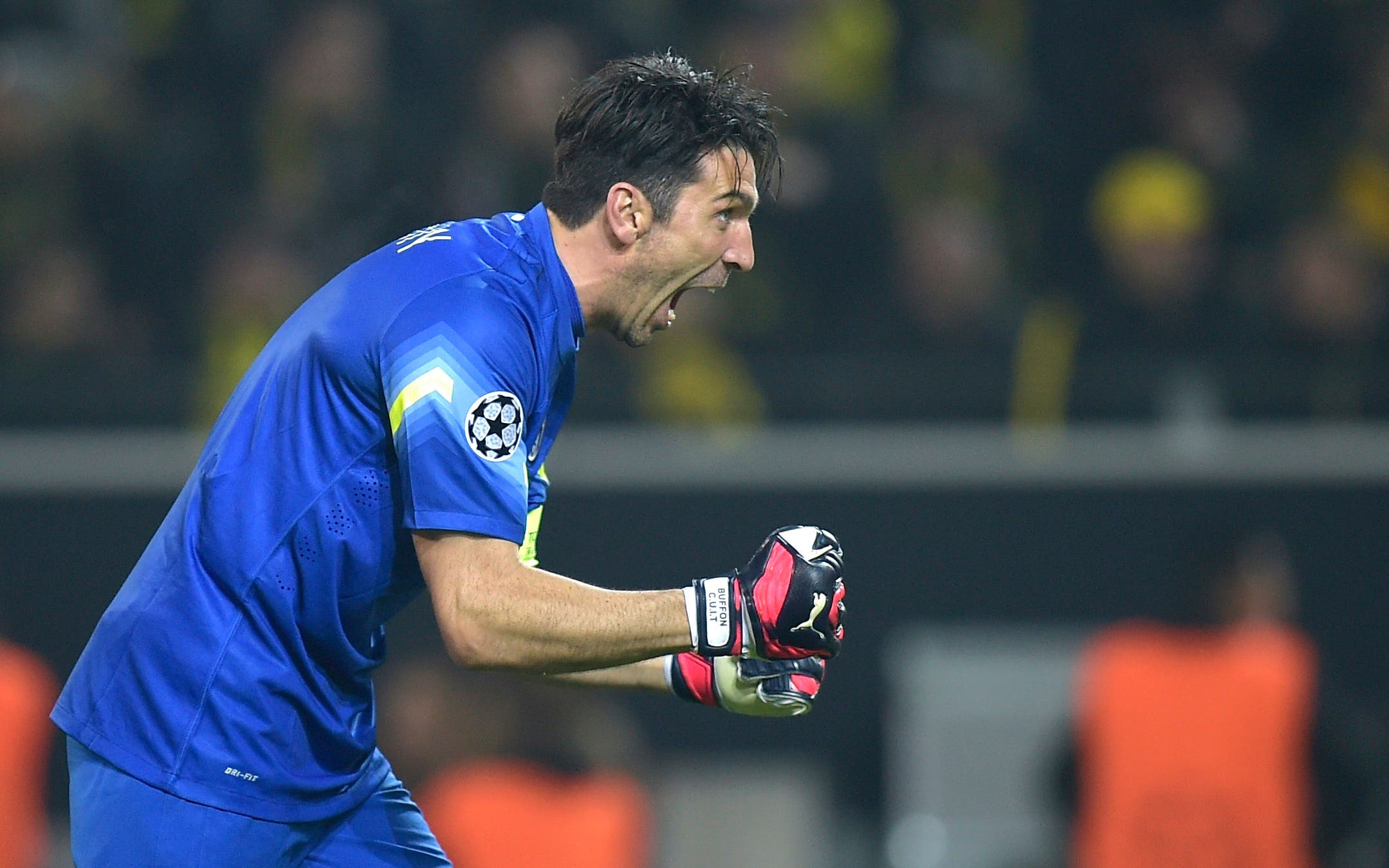 In this Wednesday, March 18, 2015 file photo Juventus goalkeeper Gianluigi Buffon celebrates after his team scored their second goal during the Champions League round of 16 second leg soccer match between Borussia Dortmund and Juventus Turin in Dortmund, Germany. (AP Photo/Martin Meissner, File)