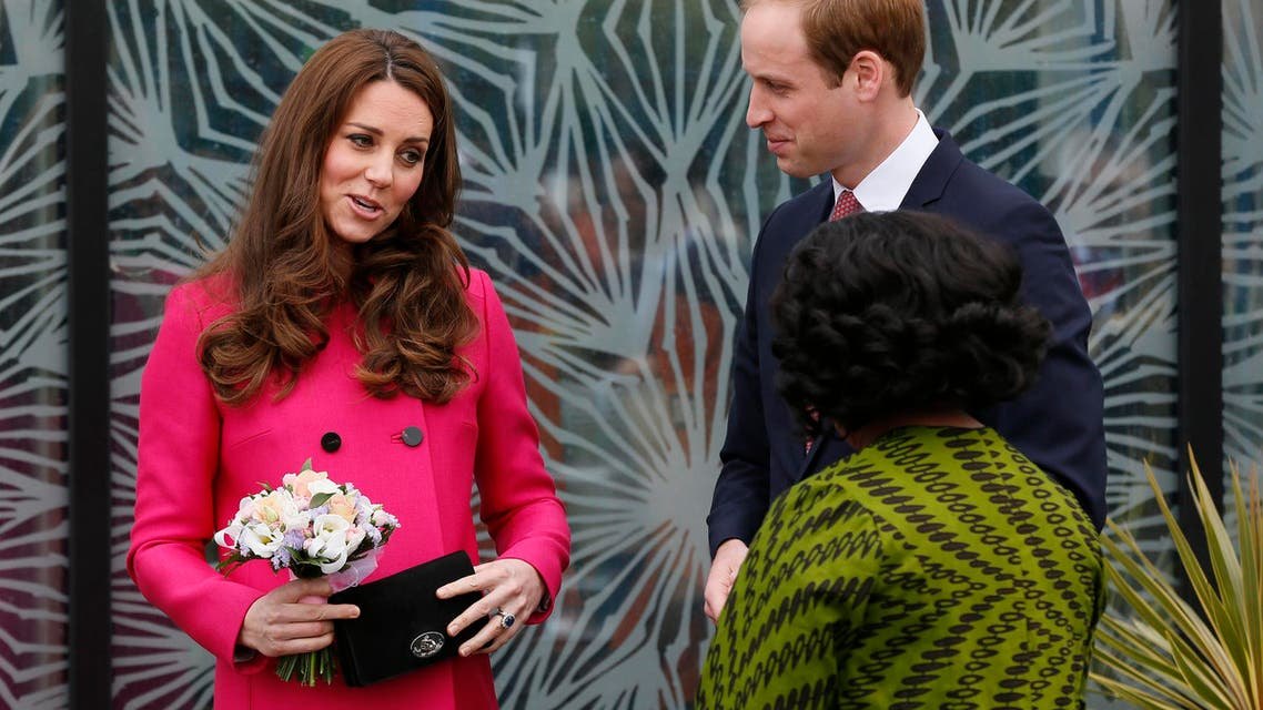 Britain's Prince William, Duke of Cambridge, and his wife Catherine, Duchess of Cambridge, leave the Stephen Lawrence Centre in south east London March 27, 2015. Reuters