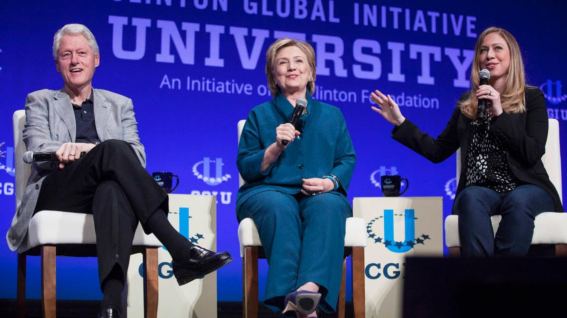 Former U.S. President Bill Clinton (L to R), former Secretary of State Hillary Clinton, and Vice Chair of the Clinton Foundation, Chelsea Clinton, discuss the Clinton Global Initiative University during the closing plenary session on the second day of the 2014 Meeting of Clinton Global Initiative University at Arizona State University in Tempe, Arizona in this March 22, 2014 file photo