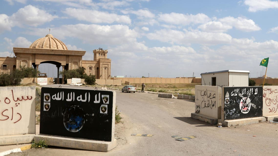 Signs belonging to the ISIS group remain at the entrance of one of Saddam Hussein's palaces in Tikrit, April 2, 2015. (File Photo:AP)