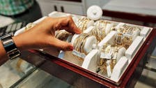 Gold firms near $1,200, poised for second weekly dip