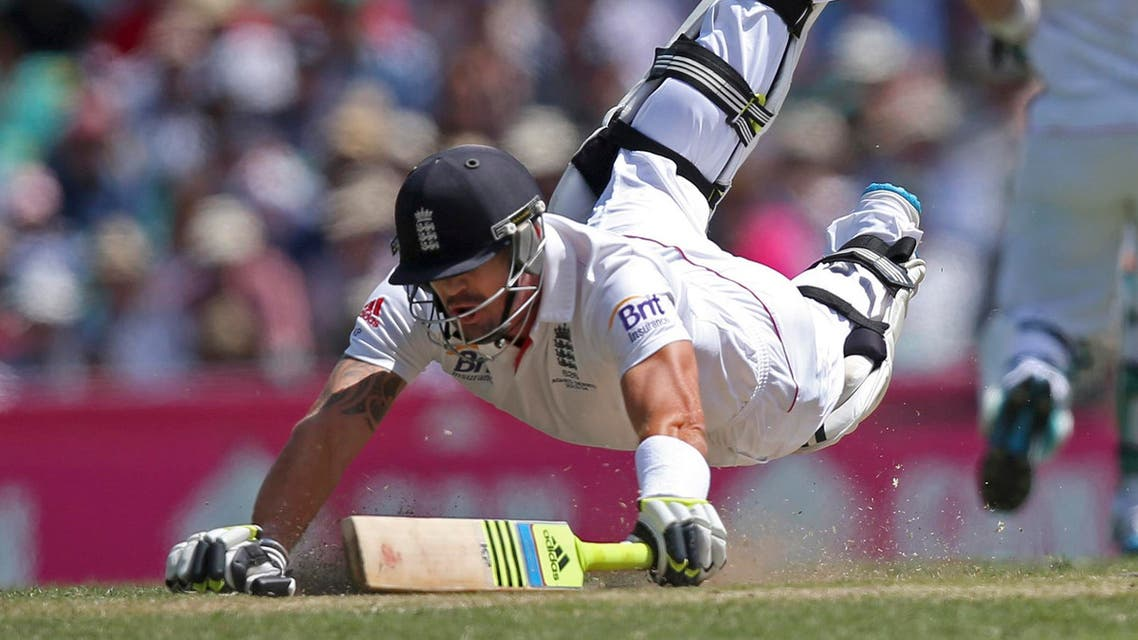 England's Kevin Pietersen dives to make his ground during a runout attempt by Australia, during their Ashes cricket Test match at the Sydney Cricket Ground in Sydney, in this file photo dated Saturday, Jan. 4, 2014. Pietersen's England career appears to be over, it is announced Tuesday Feb. 4, 2013, after the brash batsman was not selected for the upcoming tour of West Indies. Pietersen has attracted controversy during his playing career and accused of being a divisive influence within the England team, but he went on to play 104 Test matches, 136 one-day games and 37 Twenty20 fixtures for England. (AP Photo/Rick Rycroft, FILE)