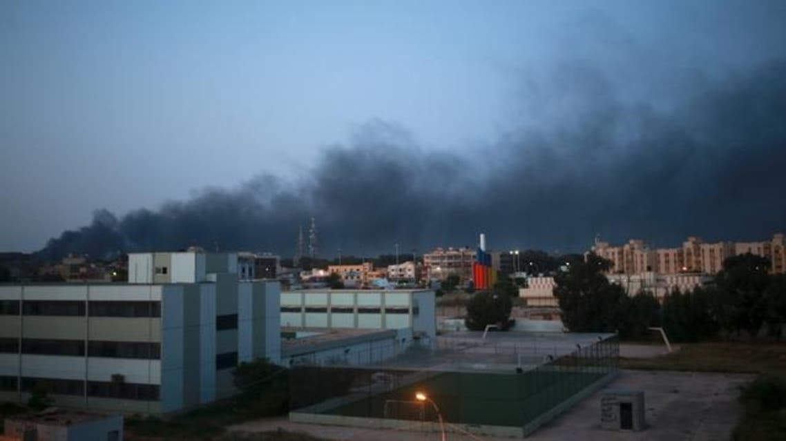 Black smoke billows in the sky above areas where clashes are taking place between pro-government forces, who are backed by the locals, and the Shura Council of Libyan Revolutionaries, an alliance of former anti-Gaddafi rebels, who have joined forces with the Islamist group Ansar al-Sharia, in Benghazi April 18. (Reuters)