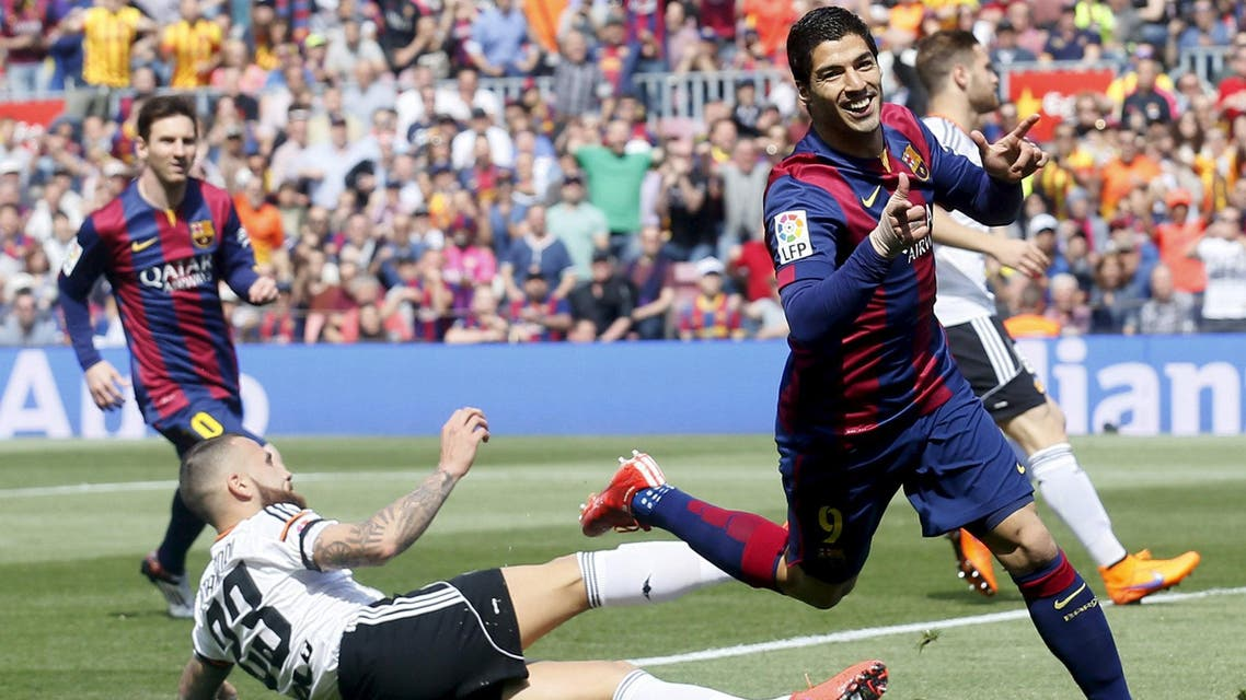 Barcelona's Luis Suarez (R) celebrates a goal against Valencia's Otamendi during their Spanish first division soccer match at Camp Nou stadium in Barcelona April 18, 2015. reuters