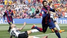 Messi, Suarez score as Barcelona beats Valencia 2-0