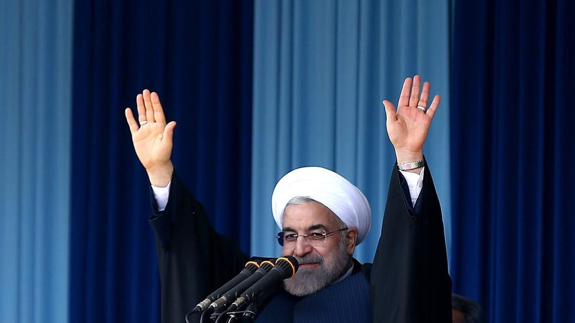 A handout picture released by the official website of the Iranian President Hassan Rouhani shows him waving to the crowd during a public meeting in the northern city of Rasht on April 15, 2015. (File: AFP)
