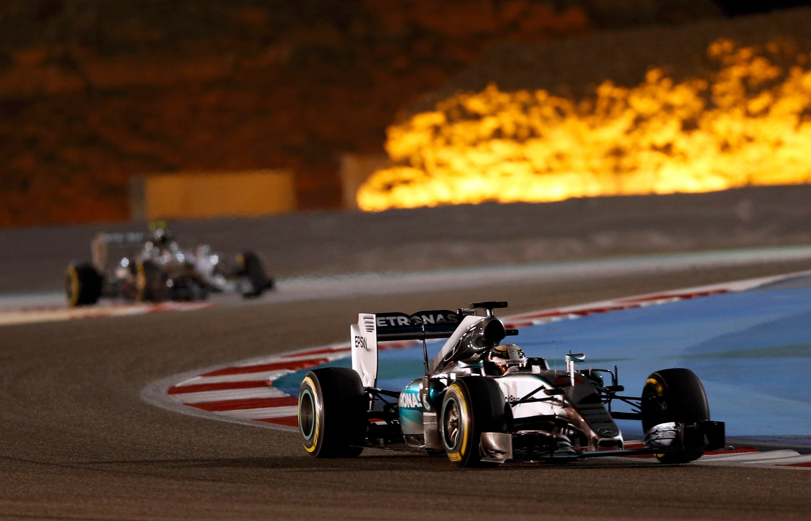 Mercedes Formula One driver Lewis Hamilton (R) of Britain drives during Bahrain's F1 Grand Prix at Bahrain International Circuit, south of Manama April 19, 2015. (Reuters)