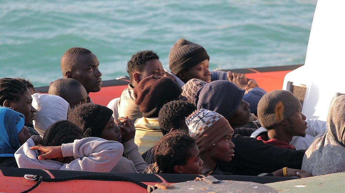 Migrants on a Coast Guard dinghy boat arrive at the Sicilian Porto Empedocle harbor, Italy, Monday, April 13, 2015. (Reuters)