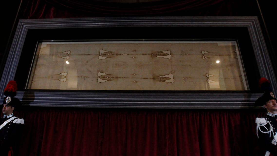 The Holy Shroud, the 14 foot-long linen revered by some as the burial cloth of Jesus, is on display during a preview for the press at the Cathedral of Turin, Italy, Saturday, April 18, 2015. (AP)