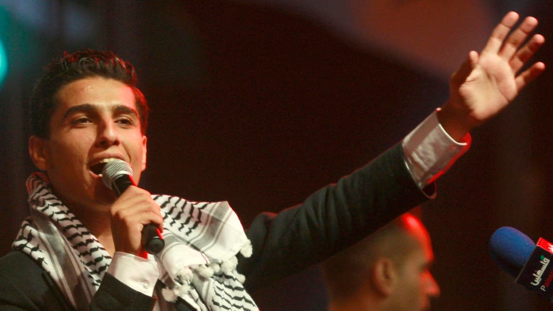 """In this July 1, 2013 file photo, Mohammed Assaf, the 23-year-old from the Gaza Strip who won the popular pan-Arab song contest """"Arab Idol"""" last month performs in the West Bank city of Ramallah. (AP)"""