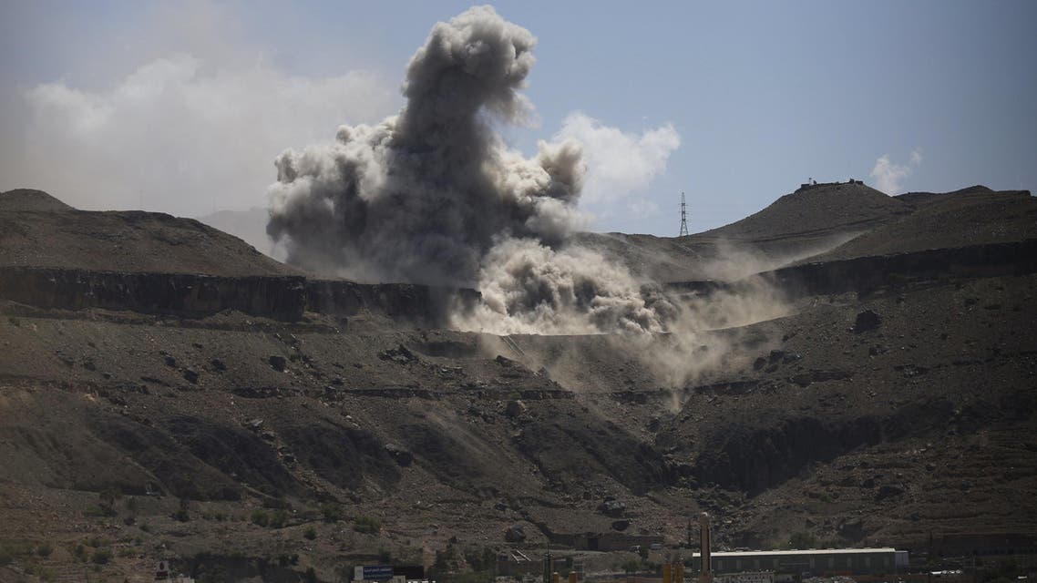 2Dust rises from the site of army weapons depots hit by an air strike in Sanaa April 18, 2015.  (Reuters)