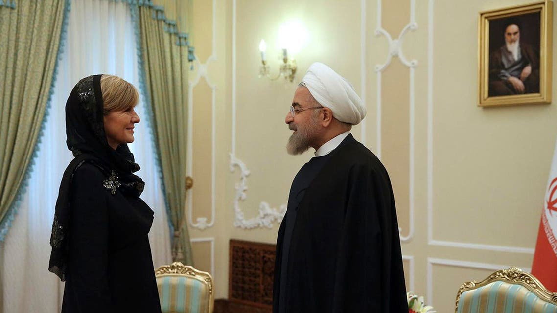 Iran's President Hassan Rouhani, right, greets Australian Foreign Minister Julie Bishop at the start of their meeting in Tehran, Iran, Saturday, April 18, 2015. (AP)