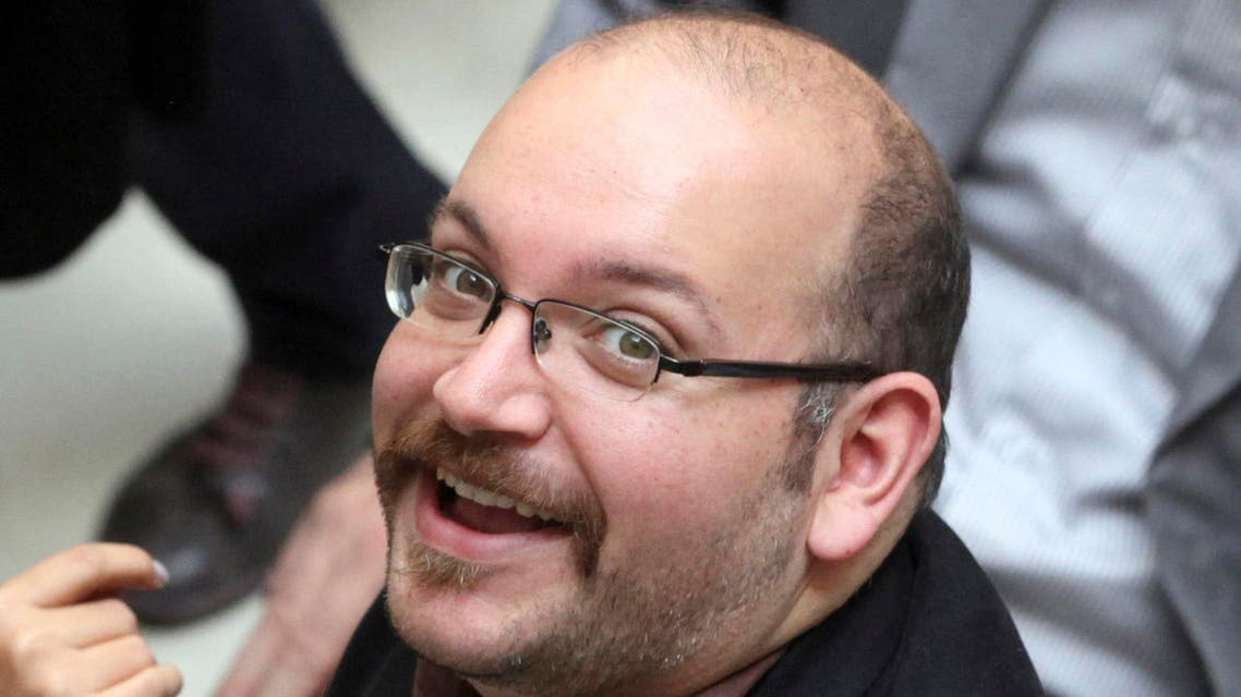 Jason Rezaian, an Iranian-American correspondent for the Washington Post, smiles as he attends a presidential campaign of President Hassan Rouhani in Tehran, Iran. (AP)