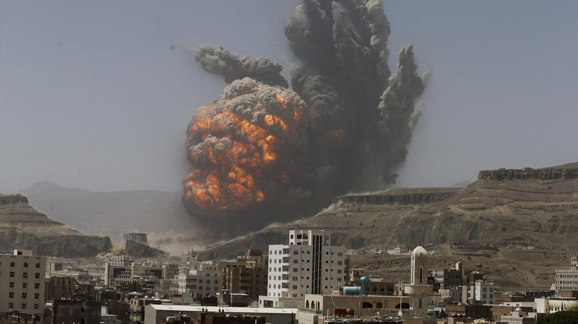 Smoke rises during an air strike on an army weapons depot on a mountain overlooking Yemen's capital Sanaa. (Reuters)