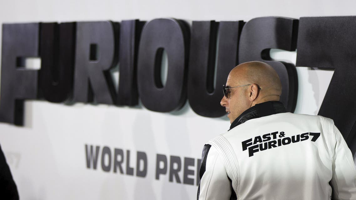 """Cast member Diesel poses at fans at the premiere of """"Furious 7"""" at the TCL Chinese theatre in Hollywood. (AP)"""