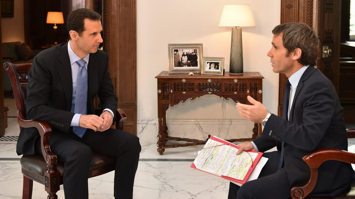Syrian President Bashar al-Assad answering questions from France 2 journalist David Pujadas during an interview in Damascus. (AFP)