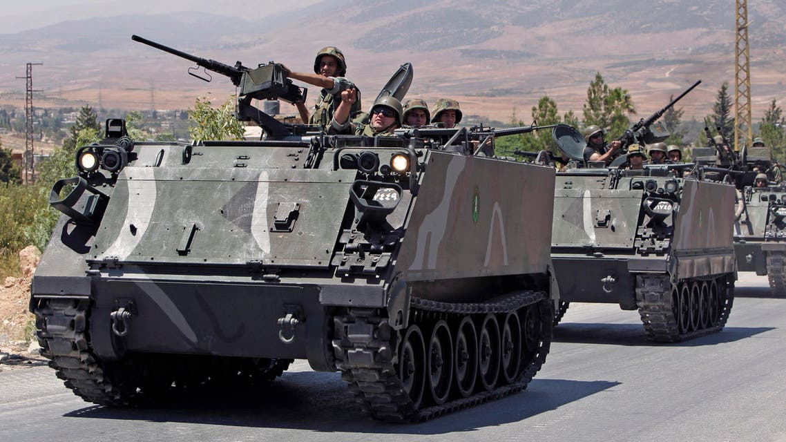 Lebanese army reinforcements arrive to the outskirts of Arsal, a predominantly Sunni Muslim town near the Syrian border in eastern Lebanon, Monday, Aug. 4, 2014. (AP)
