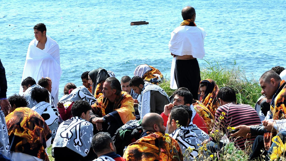 Migrants are seen on the shore in the eastern Aegean island of Rhodes, Geece on Monday, April 20, 2015. (AP)