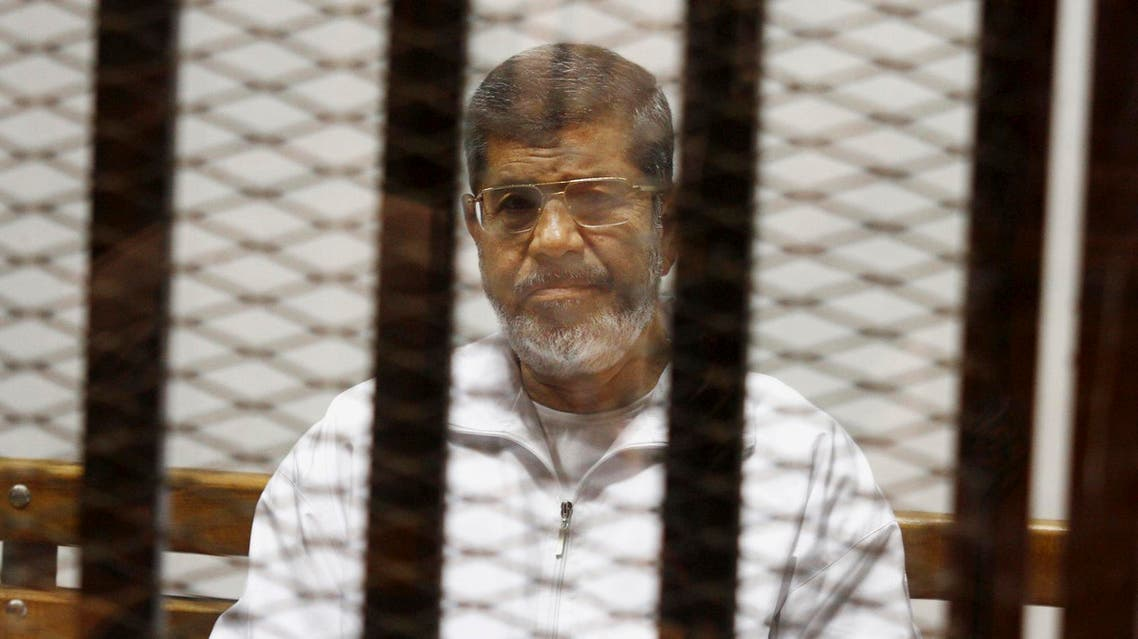 In this May 8, 2014 file photo, Egypt's ousted Islamist President sits in a defendant cage in the Police Academy courthouse in Cairo. (AP)