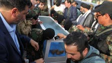 'Body of Saddam Hussein aide' paraded in glass coffin
