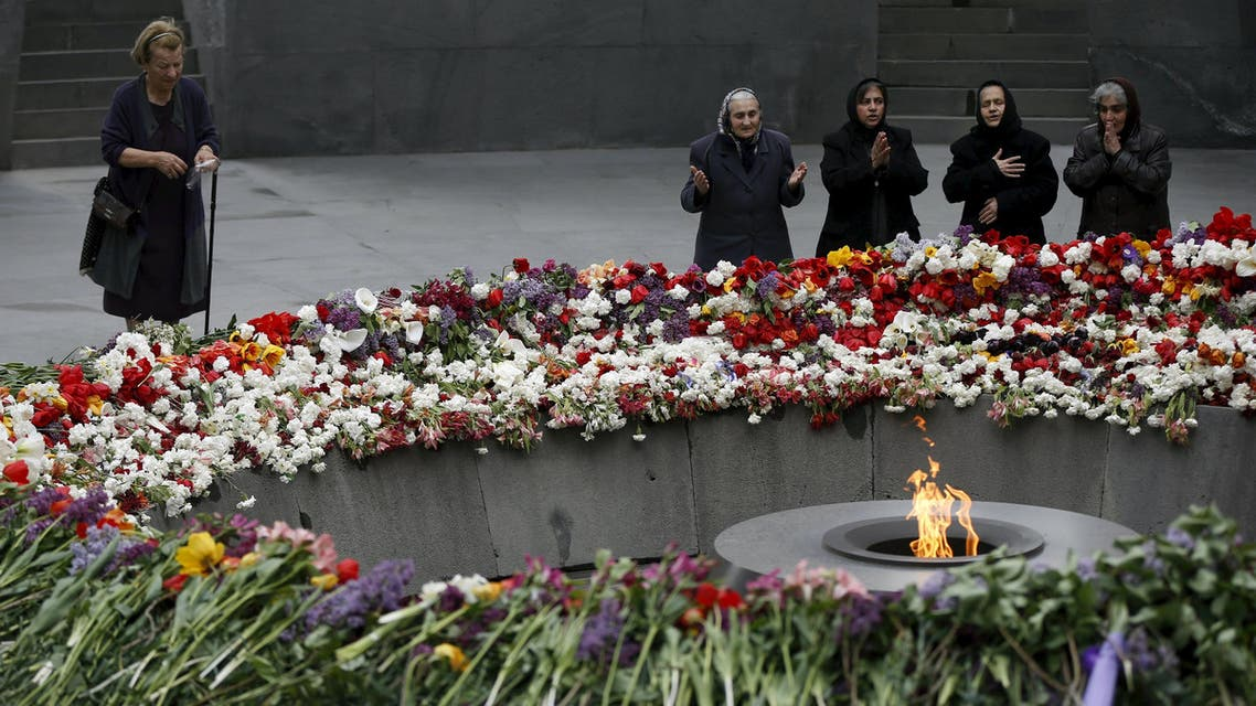 People mourn at the Tsitsernakaberd Armenian Genocide Memorial Museum in Yerevan, April 21, 2015. REUTERS