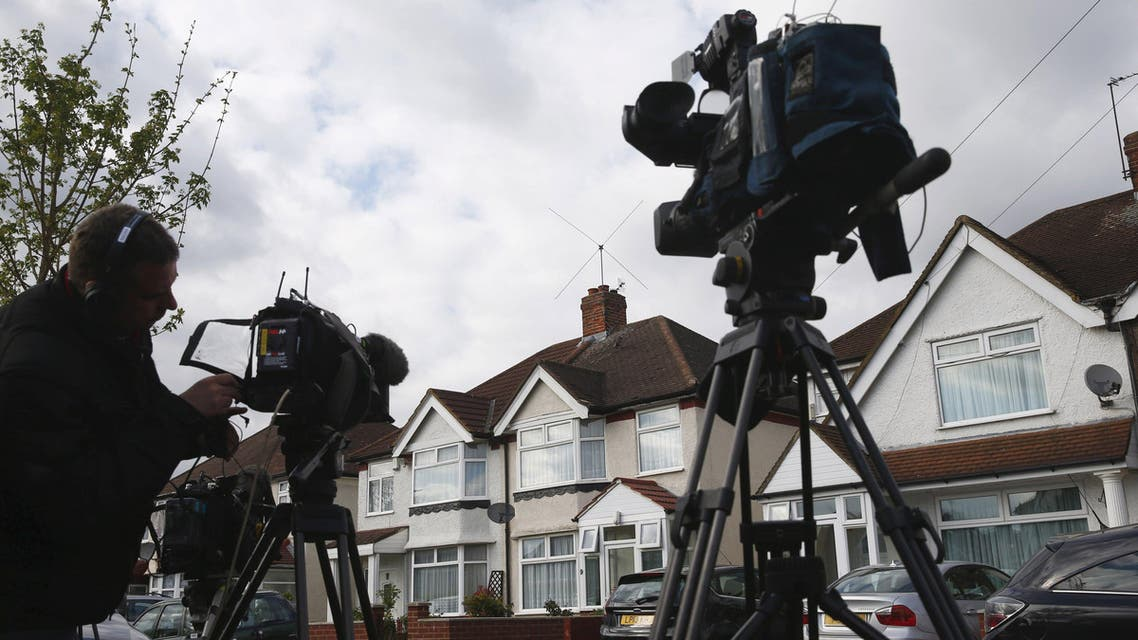 elevision crews wait outside the address where Nav Sarao Futures Limited is registered, in Hounslow, west London April 22, 2015. (Reuters)