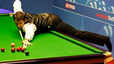 Snooker star causes stir by playing in socks at world champs