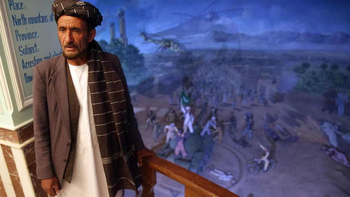 In thiIn this Sunday, April 12, 2015 photo, tour guide Sayed Hassan, speaks during an interview with The Associated Press, at the Jihad Museum, in Herat city.
