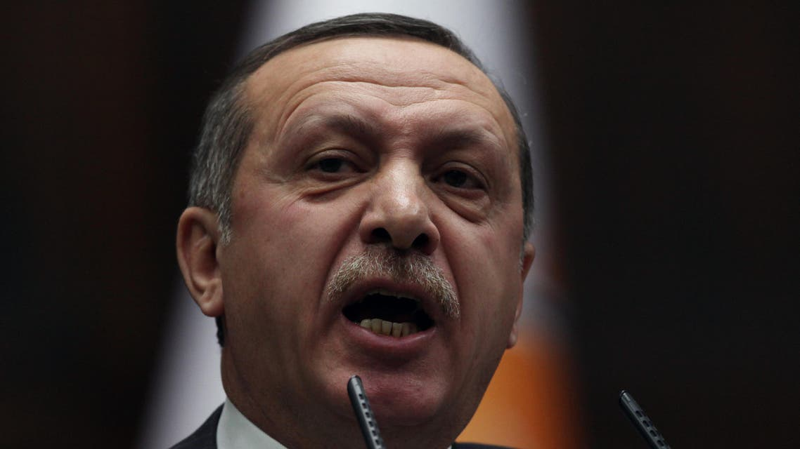 Turkish Prime Minister Recep Tayyip Erdogan addresses lawmakers and supporters of his party at the parliament in Ankara, Turkey, Tuesday, Jan. 24, 2012, a day after France's Senate voted a law that would make it a crime in France to deny that the killing of Armenians in the Ottoman Empire nearly a century ago was a genocide. AP