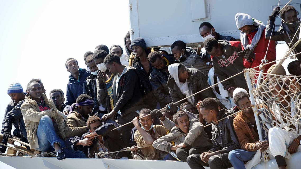 Migrants wait to disembark from the Italian Navy vessel 'Chimera' in the harbor of Salerno, Italy, Wednesday, April 22, 2015. (AP)