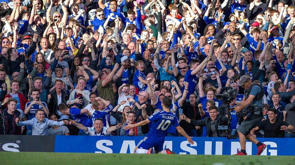 Chelsea's Eden Hazard, celebrates after scoring against Manchester United, during the English Premier League soccer match between Chelsea and Manchester United, at Stamford Bridge Stadium in London, Saturday, April 18, 2015. (AP Photo/Bogdan Maran)
