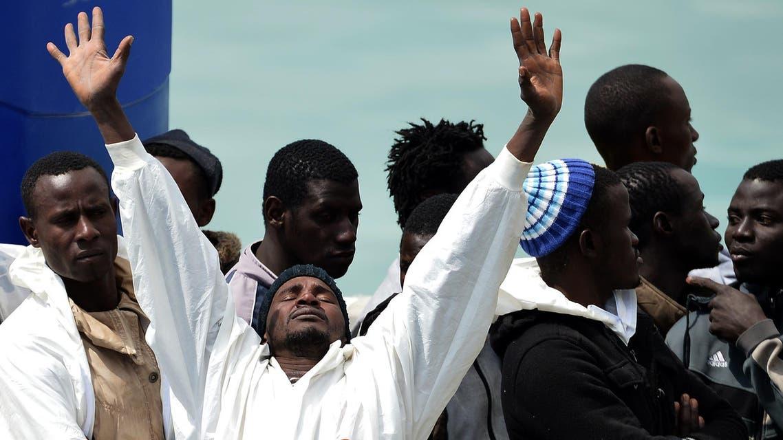 Rescued migrants disembark off the Italian Guardia Costiera vessel Fiorillo at the Sicilian harbour of Catania on April 24, 2015. (AFP)