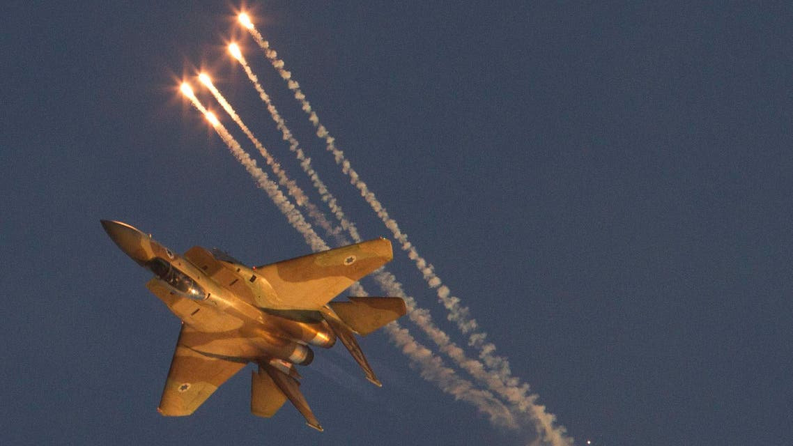 An Israeli Air Force F15I fighter jet releases flares during an acrobatics display during a graduation ceremony at the Hatzerim Air Force base near the southern city of Beersheba, Israel,Thursday, June 28, 2012.  (AP)