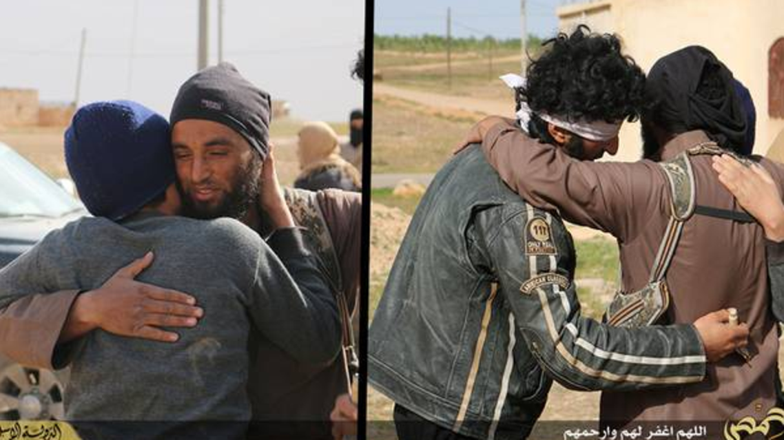 Macabre images show ISIS militants hugging men before deadly stoning (Courtesy of The Independent)