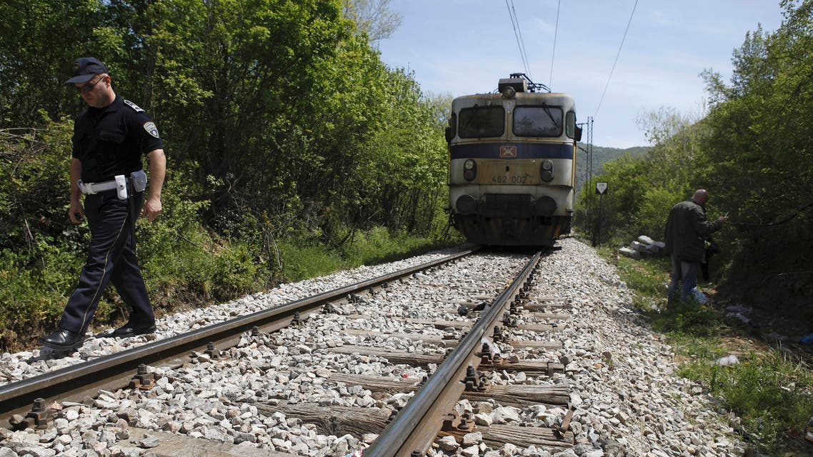 A police officer walks along the rail tracks north of the central Macedonian town of Veles, on Friday, April 24, 2015 near where 14 migrants were killed by a train while walking along the tracks. (AP)